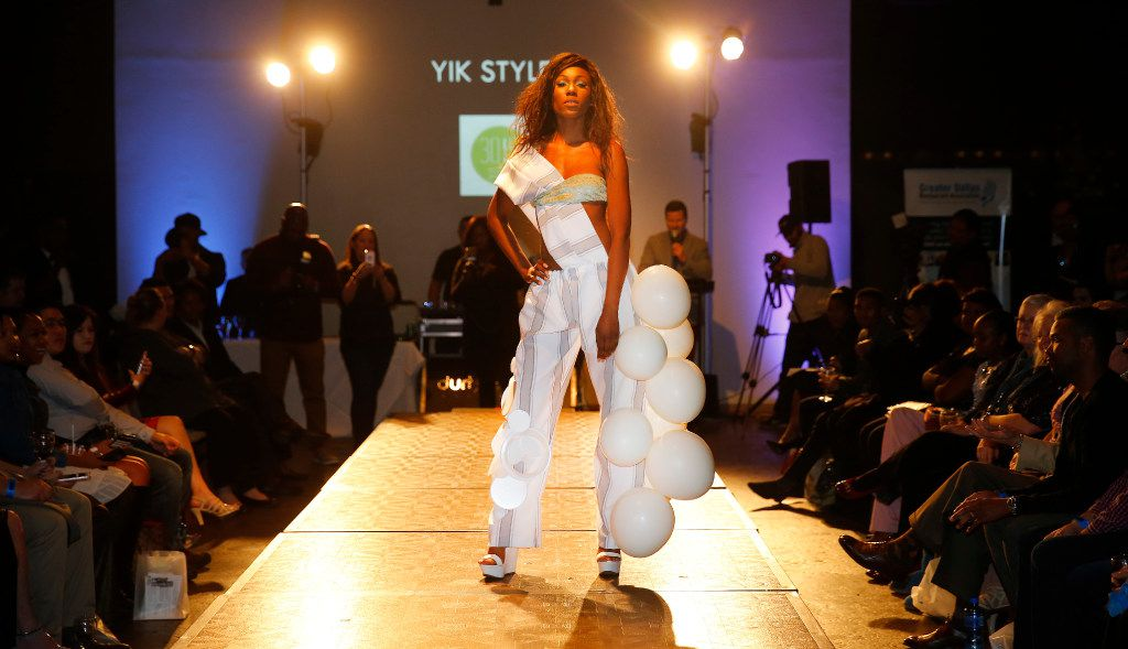 Model Cortni Wright shows off her outfit made with tablecloths, Styrofoam plates and balloons. The dress was designed by Sharon Yik under the label Yik Styles.