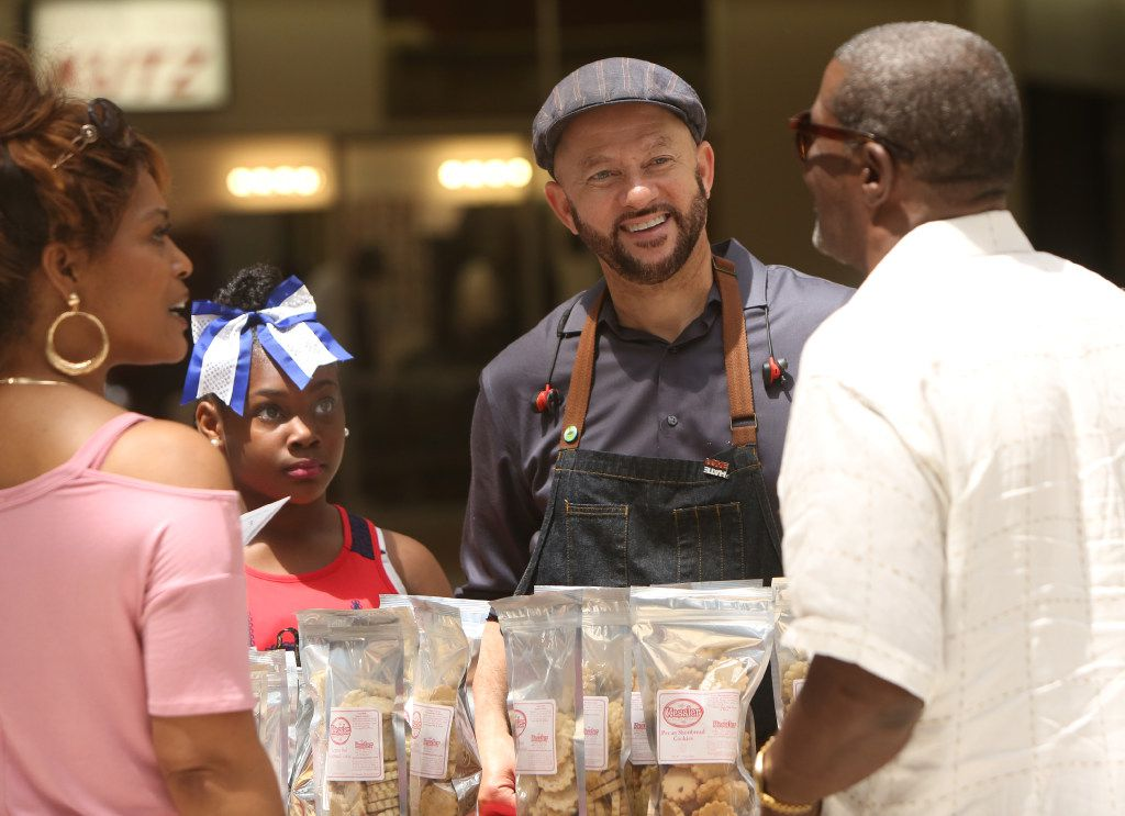 Clyde Greenhouse, and his assistant, Cynara Harrison, share a light moment with customers at a booth set up to offer cookies for sale. Representing the small business, Kessler baking Studio in Dallas, the two were marketing the company's wares to mall shoppers. The North Texas Black Restaurant Week held its kickoff event at Southwest center Mall in Dallas on May 17, 2017.
