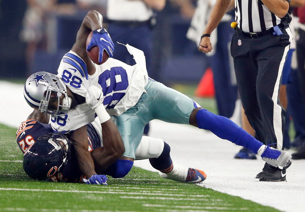 Dallas Cowboys wide receiver Dez Bryant (88) gets pulled down with his foot caught underneath Chicago Bears inside linebacker Christian Jones (52) as he attempts to break free on a pass play during the first quarter of play at AT&T Stadium in Arlington on Sunday, September 25, 2016. (Vernon Bryant/The Dallas Morning News)