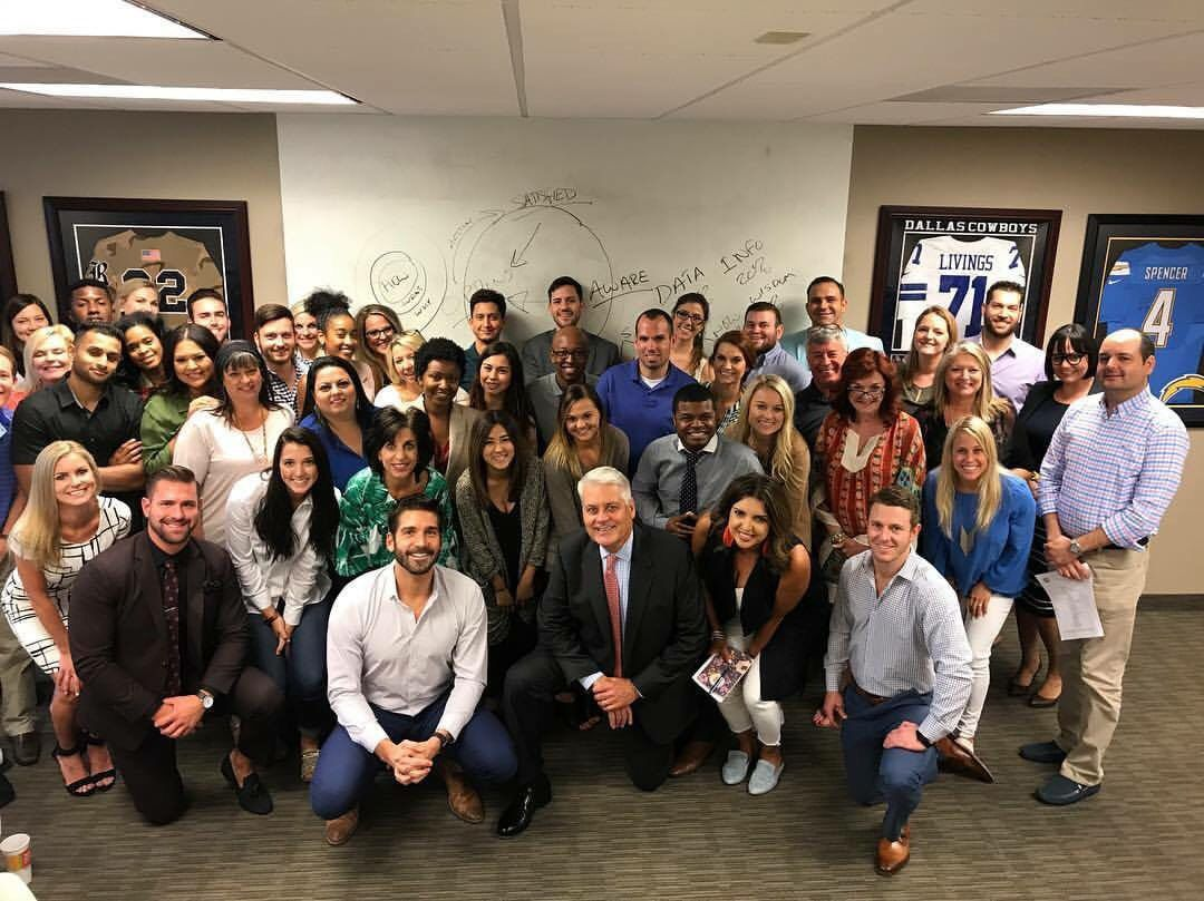 The staff at Rogers Healy and Associates Real Estate gathered for a group shot.