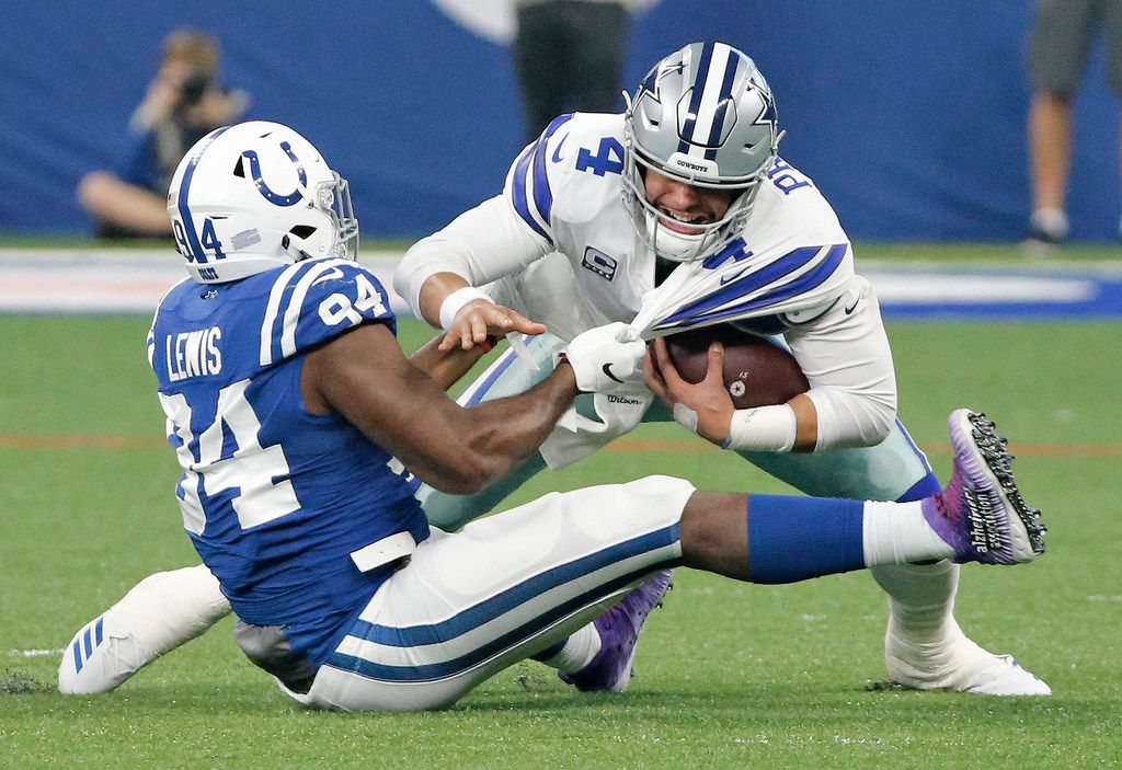 Dallas Cowboys quarterback Dak Prescott (4) is sacked by Indianapolis Colts defensive end Tyquan Lewis (94) in the first quarter during the Dallas Cowboys vs. the Indianapolis Colts NFL football game at Lucas Oil Stadium in Indianapolis on Sunday, December 16, 2018. (Louis DeLuca/The Dallas Morning News)