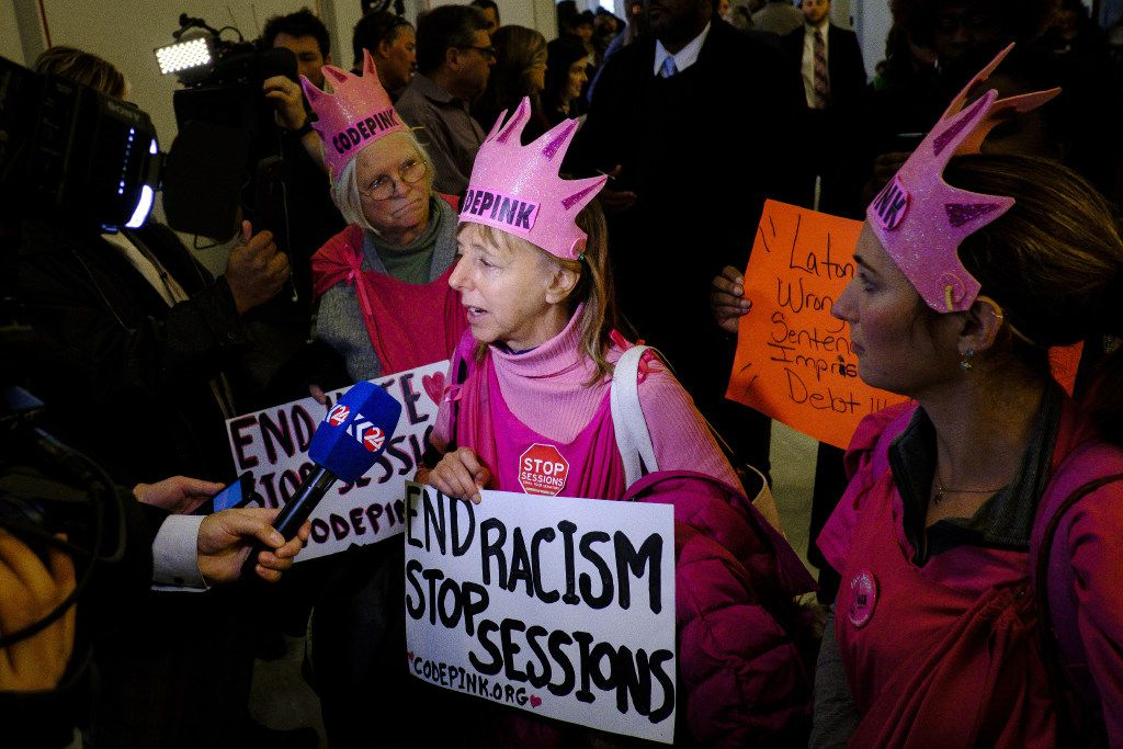 Code Pink activists speak to the media outside of Session's confirmation hearing.