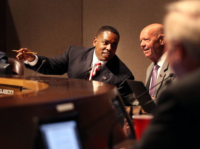 Plano Mayor Harry LaRosiliere conferred with City Manager Bruce Glasscock during Tuesday night's City Council meeting.
