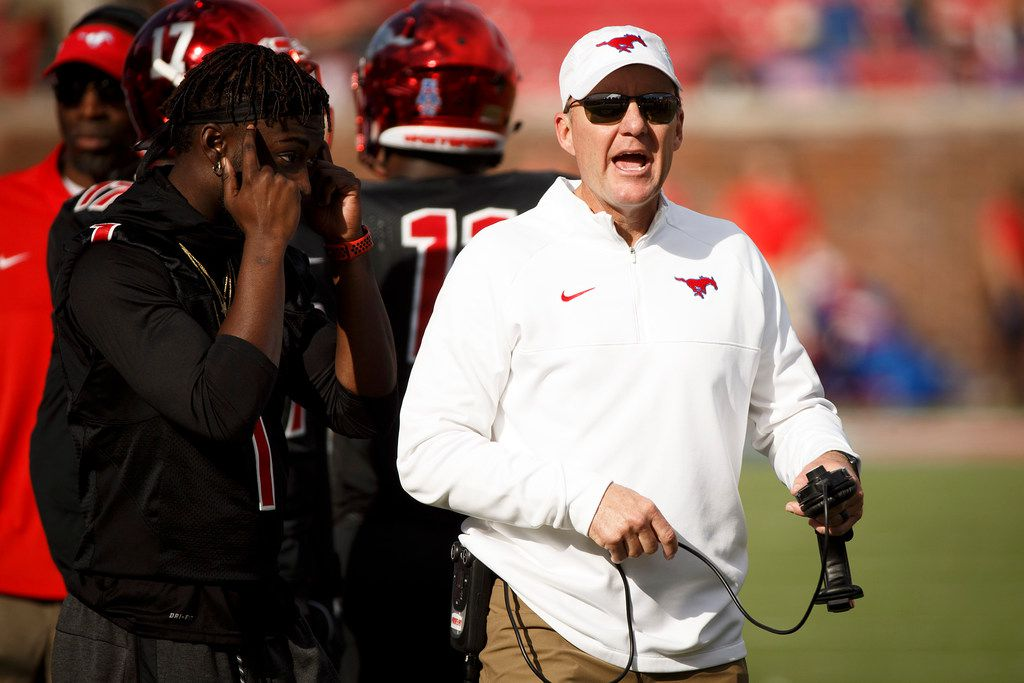 In this Nov. 25, 2017 file photo, head coach Chad Morris yells toward officials during a timeout in the second half of SMU's game against Tulane at Ford Stadium in Dallas. Arkansas hired Morris to be its head coach in December. (Smiley N. Pool/The Dallas Morning News)