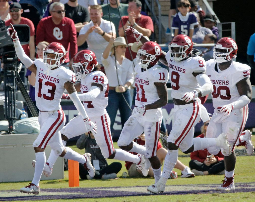 OU defenders Tre Norwood (13), Brendan Radley-Hiles (44), Parnell Motley (11), Kenneth Murray (9) and Neville Gallimore (90) celebrate as they run off the field after a second-half interception during the Oklahoma Sooners vs. the TCU Horned Frogs NCAA football game at Amon G. Carter Stadium in Fort Worth, Texas on Saturday, October 20, 2018. (Louis DeLuca/The Dallas Morning News)