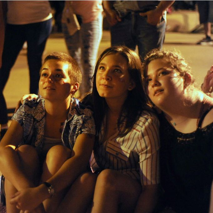 Friends watch the fireworks on the Margaret Hint Hill Bridge at Red, White, and Boom on the Bridge.