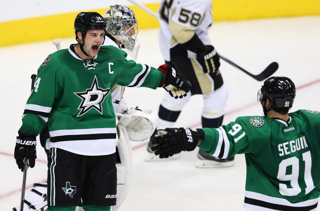 Dallas Stars left wing Jamie Benn (14) celebrates with teammate Dallas Stars center Tyler Seguin (91) after scoring a goal on Pittsburgh Penguins goalie Marc-Andre Fleury (29) during the third period of play in the home opener at American Airlines in Dallas on Thursday, October 8, 2015. Dallas Stars defeat the Pittsburgh Penguins 3-0. (Vernon Bryant/The Dallas Morning News)