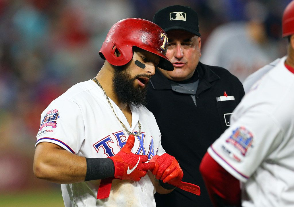 ARLINGTON, TX - AUGUST 03: Eric Cooper #56 umpire talks with Rougned Odor #12 of the Texas Rangers after Odor was hit with a pitch in the sixth inning  against the Detroit Tigers at Globe Life Park in Arlington on August 3, 2019 in Arlington, Texas. (Photo by Rick Yeatts/Getty Images)