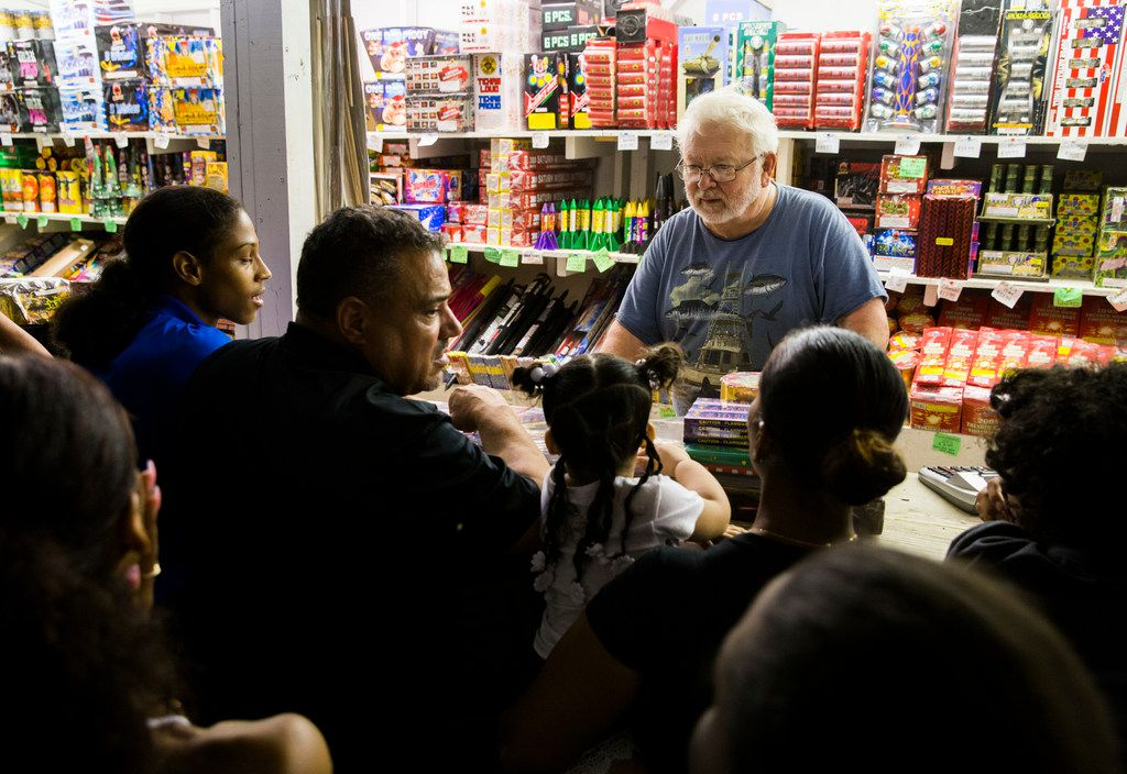 Malcolm Wilson sells fireworks to customers at Palmer Fireworks on Dowdy Ferry Road in Dallas on Friday.