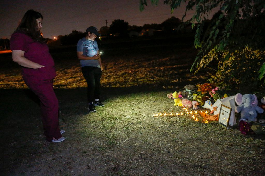 Jasmin Garrido, left, and Noelia Contrera look at a small tribute set up for Sherin Mathews on Thursday October 12, 2017. Sherin went missing from an alley behind her house in Richardson, Texas on Saturday, October 7, 2017. (Ron Baselice/The Dallas Morning News)
