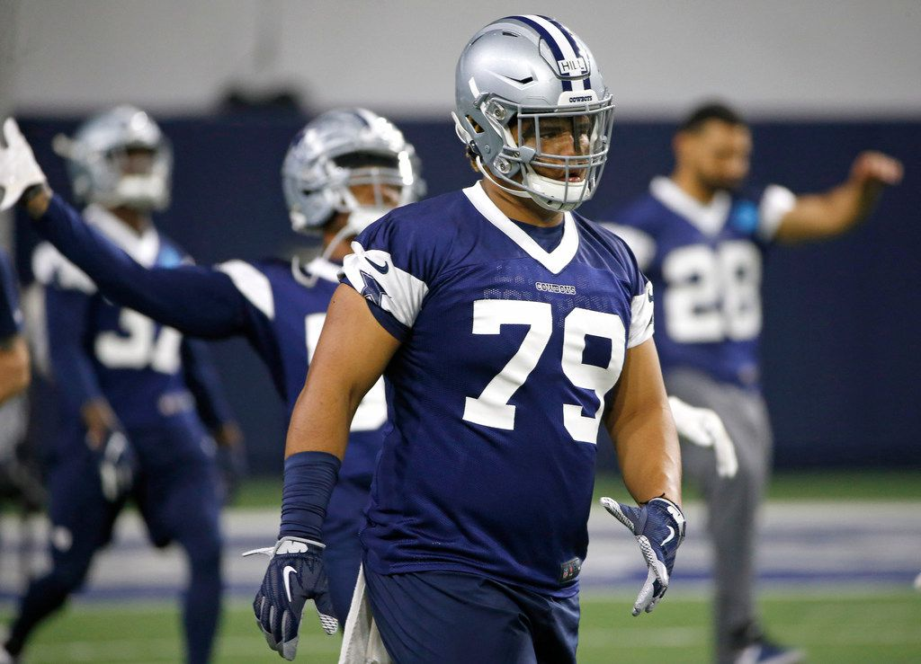 Dallas Cowboys defensive tackle Trysten Hill (79) warms up with teammates during an organized team activity at its NFL football training facility in Frisco, Texas, Wednesday, May 29, 2019. (AP Photo/Ron Jenkins)