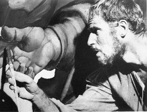 """Michelangelo, played by Charlton Heston, is shown at work in a scene from the movie """"The Agony and the Ecstasy"""" based on the 1961 novel. (File Photo/The Associated Press)"""