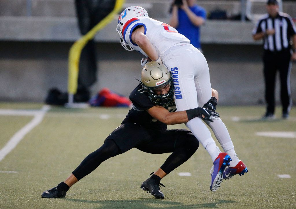 Birdville's Cooper McCasland (17) tackles Grapevine's Caleb Edwards on a kick return during the first half of their high school football game in North Richland Hills, Texas on October 4, 2019. (Michael Ainsworth/Special Contributor)