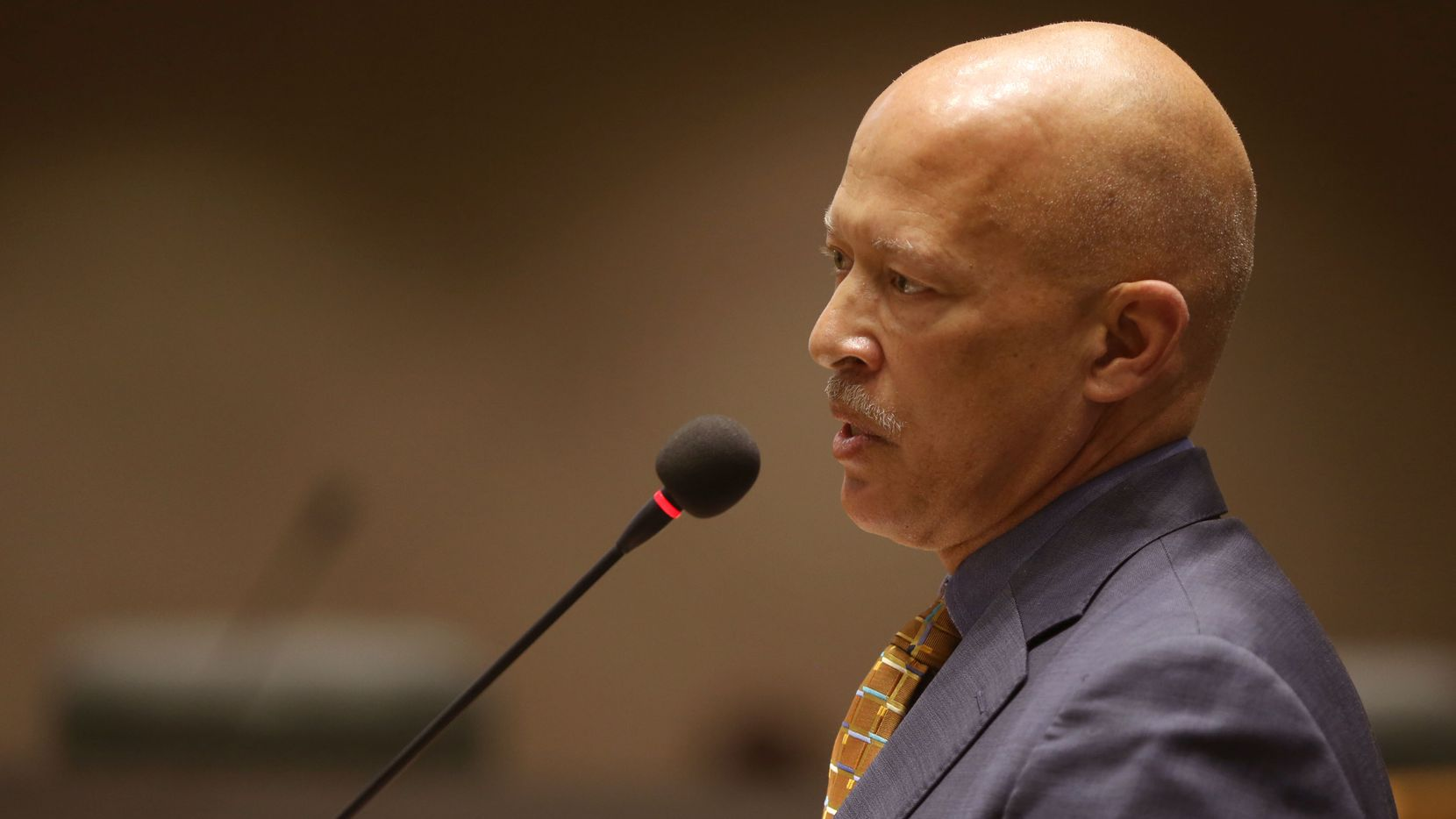 Dallas County District Attorney John Creuzot speaks to City Council members about his police reform policies during a public safety and criminal justice meeting at City Hall in Dallas on April 22, 2019.