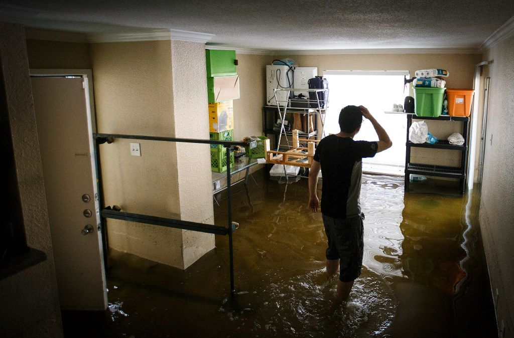 Jeff Liu pauses while retrieving his belongings from his west Houston apartment which was still flooded with about a foot of water from Hurricane Harvey on Saturday, Sept. 2, 2017, in Houston.