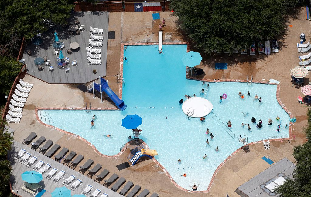 People take a break from the 100 plus degree hot weather in The Texas Pool in Plano on Friday, July 20, 2018. (Vernon Bryant/The Dallas Morning News)