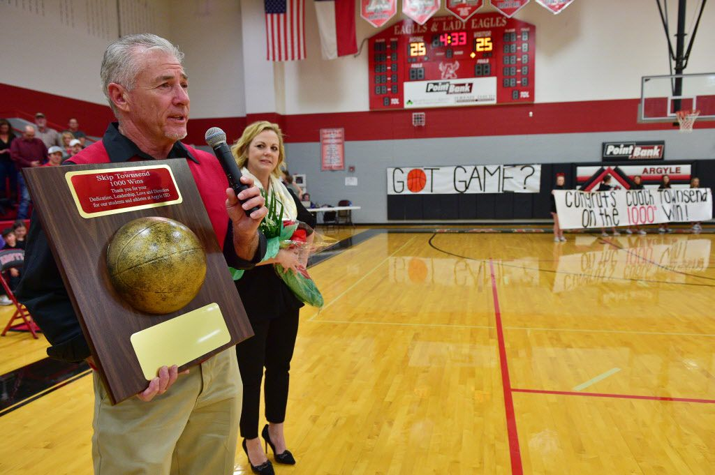 Argyle girls basketball head coach Skip Townsend is honored after getting his 1000th career win following a victory over Sanger, Tuesday, February 3, 2015, in Argyle, TX. David Minton/DRC