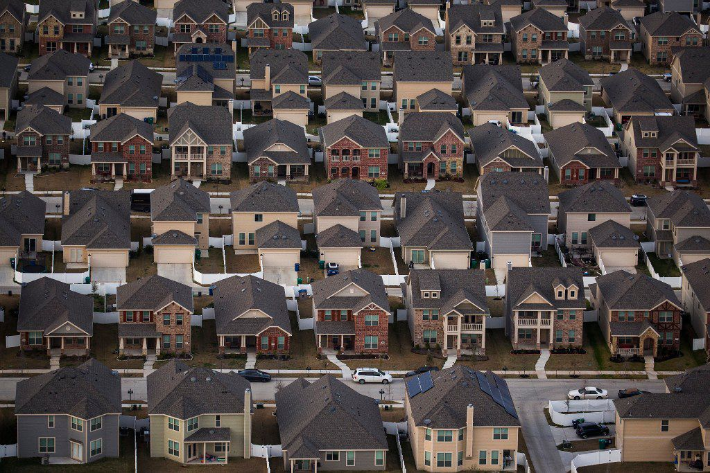 Rows of suburban homes seen in an aerial view on Monday, March 6, 2017, in Aubrey, Texas.