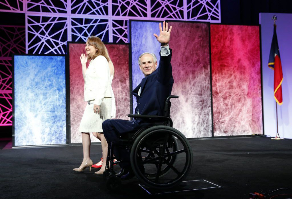 Gov. Greg Abbott, wife Cecilia and daughter Audrey Abbott wave to the crowd during the 2016 Texas Republican Convention at the Kay Bailey Hutchison Convention Center in Dallas, on Thursday, May 12, 2016.