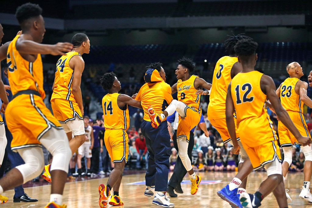 Ok Cliff celebrates after Oak Cliff Faith Academy's Jordan Walsh #23,far right hit the winning basket. UIL boys basketball 4A State Final between Oak Cliff Academy v Liberty Hill on Saturday March 9, 2019 at the Alamodome in San Antonio, Texas. (Ron Cortes/ Special Contributor) ORG XMIT: 10044099A