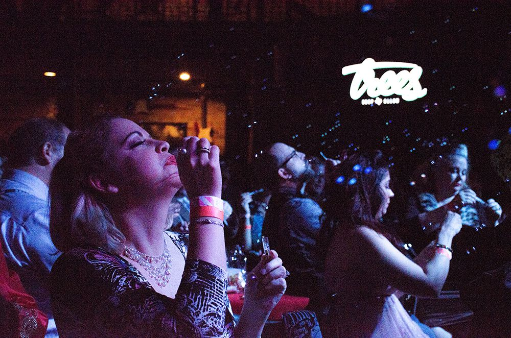 Audience members blow bubbles to bring on the next act at Trees in Deep Ellum.