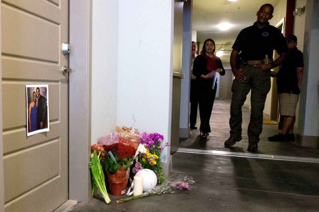 Police  patrolled the hallway outside the front door of Botham Jean days after he was shot and killed at the South Side Flats apartment.