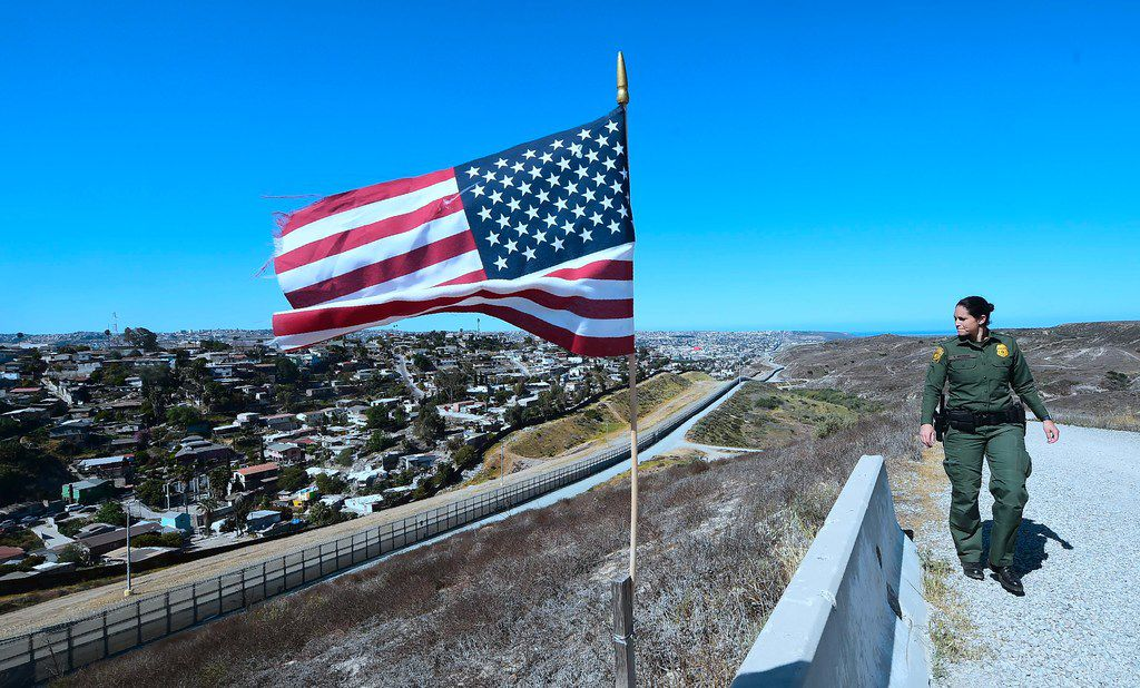 U.S. Customs and Border Protection agent Tekae Michael patrols from within the Border Infrastructure System, a no man's land area between the wall and fence which runs for 14 miles inland from the Pacific Ocean separating California from Mexico in San Diego, California, in April.