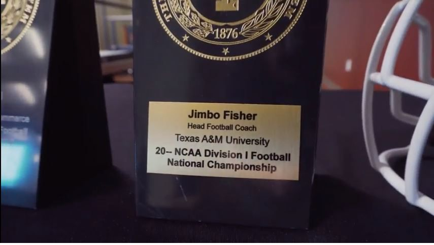A look at the championship plaque given to new Texas A&M coach Jimbo Fisher by A&M system chancellor John Sharp during a meeting in February.