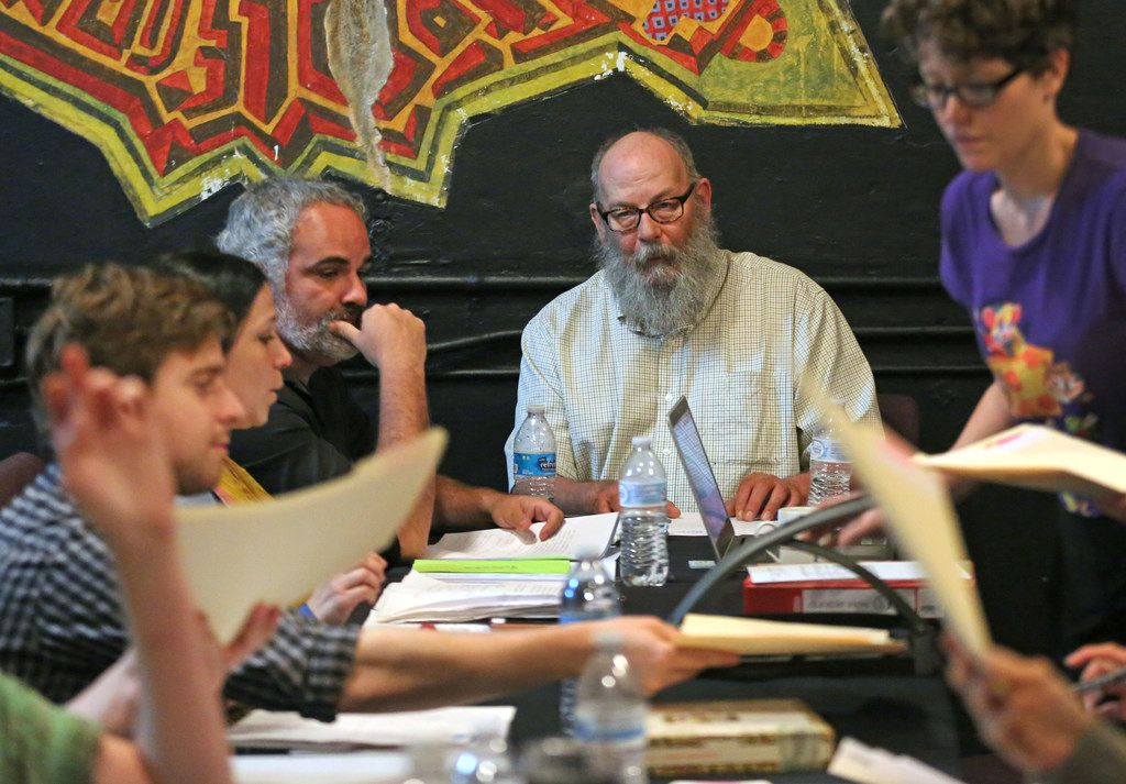 Ochre House Theater writer-director Matthew Posey (center) at a table read during the first rehearsal of Picasso: Matador de Málaga. Flamenco dancers and choreographers Antonio Arrebola and Delilah Buitrón Arrebola (seated to his right) play the painter and his second wife, Jacqueline Roque.