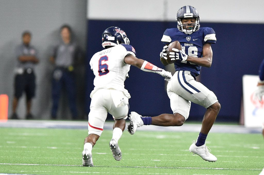 FILE - Frisco Lone Star sophomore wide receiver Marvin Mims (18) catches a pass from Frisco Lone Star senior quarterback MJ Rivers (2), while being defended by Ryan senior defensive back Tamar Butts (6) at The Ford Center at The Star, Thursday, September 21, 2017, in Frisco, Texas, Jeff Woo/DRC