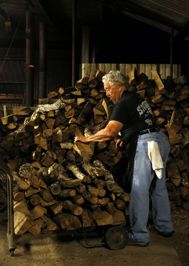 Tootsie Tomanetz gathers wood for the night.