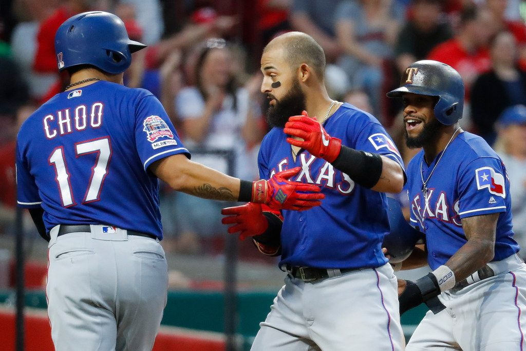 Texas Rangers' Rougned Odor, center, celebrates with Shin-Soo Choo (17) after hitting a grand slam off Cincinnati Reds relief pitcher Wandy Peralta in the fifth inning of a baseball game, Friday, June 14, 2019, in Cincinnati. (AP Photo/John Minchillo)