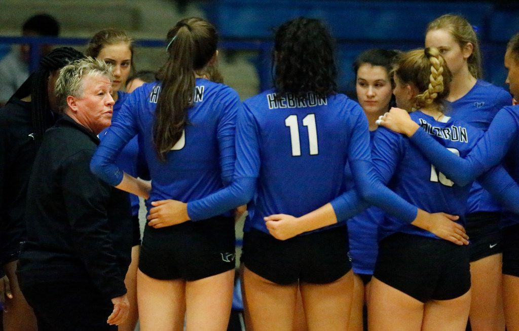 Hebron coach Karin Keeney (left) addresses her team during a timeout in a match against Plano West on August 7, 2018. (Stewart F. House/Special Contributor)