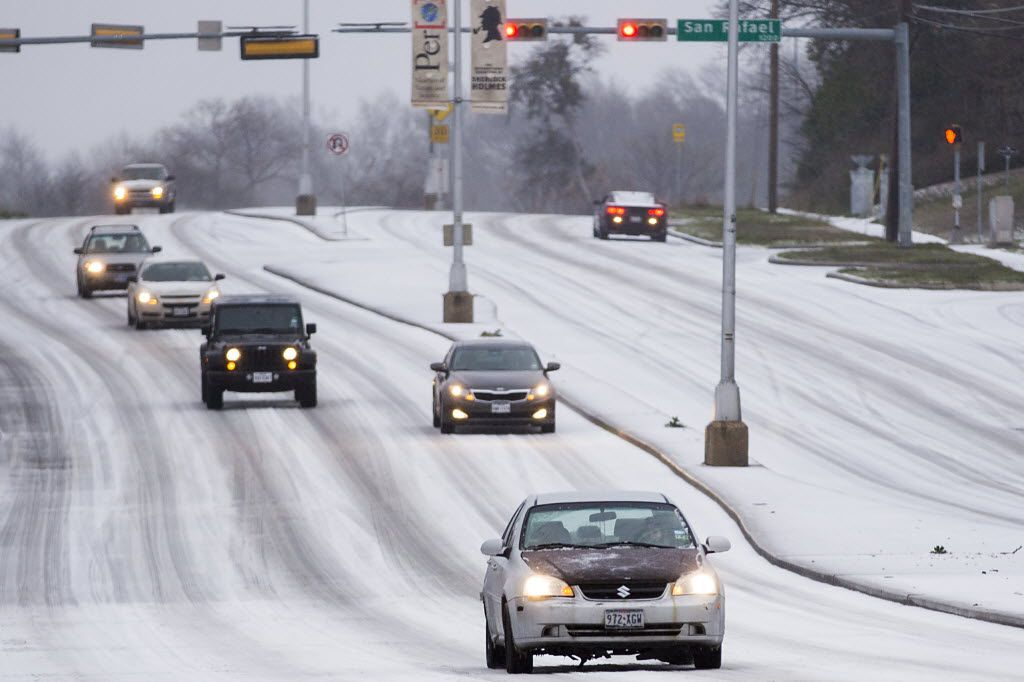 Here's a driving nightmare: Traffic moves slowly on Garland Road near White Rock Lake as icy weather descended on North Texas in February 2015.