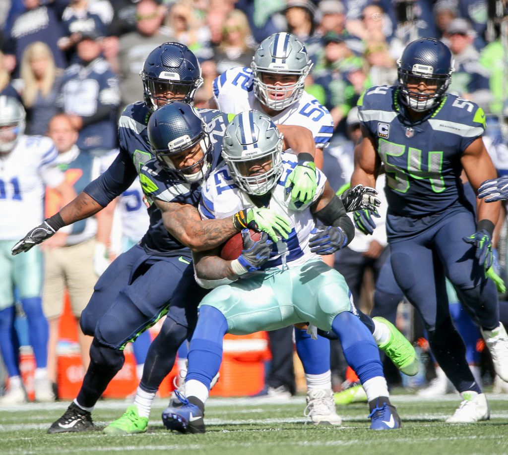 Dallas Cowboys running back Ezekiel Elliott (21) carries the ball as he is defended by Seattle Seahawks defensive back Earl Thomas (29) during the first half of an NFL game between the Dallas Cowboys and Seattle Seahawks on Sunday, September 23, 2018 at CenturyLink Field in Seattle. (Shaban Athuman/The Dallas Morning News)