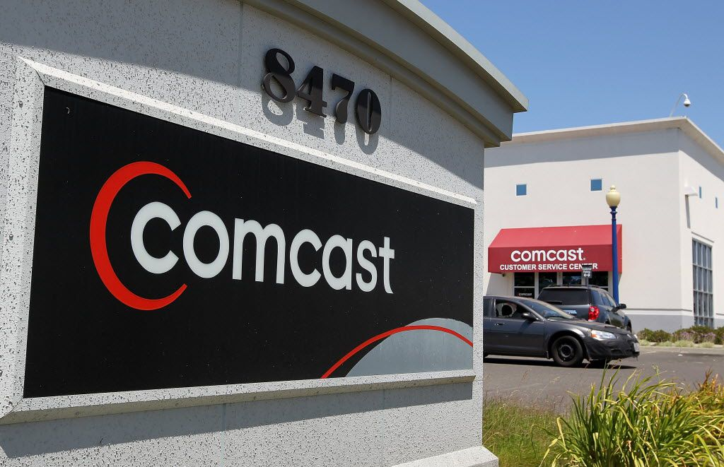 Comcast and NBCUniversal combined a major distributor with one of the leading providers of TV and movie entertainment. AT&T and Time Warner would do the same on a larger scale.  (Justin Sullivan/Getty Images)