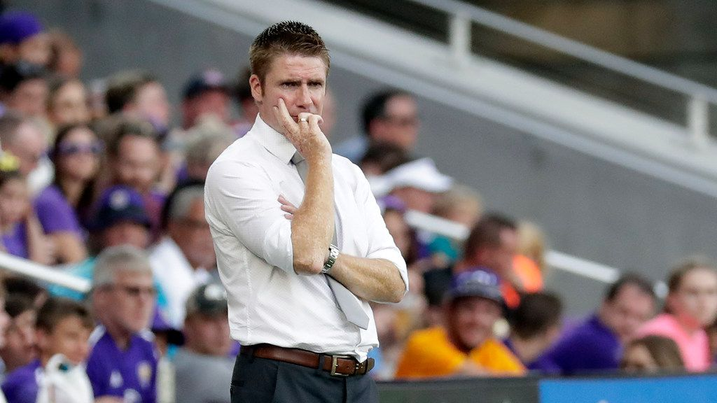 Orlando City head coach James O'Connor watches his team against the Chicago Fire during the second half of an MLS soccer match, Sunday, Oct. 6, 2019, in Orlando, Fla. (AP Photo/John Raoux)