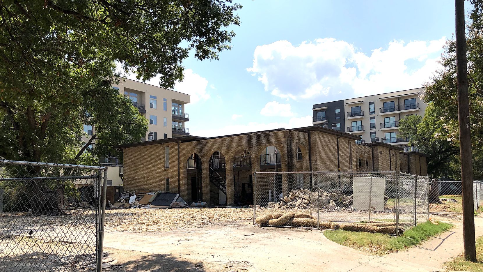 Demolition crews are busy knocking down old apartments and homes on McKinney Avenue.