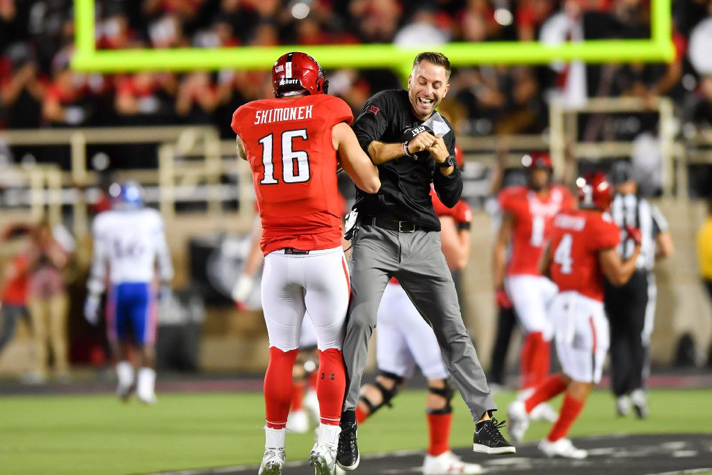 LUBBOCK, TX - SEPTEMBER 29: Nic Shimonek #16 of the Texas Tech Red Raiders and head coach Kliff Kingsbury of the Texas Tech Red Raiders celebrate a touchdown during the game against the Kansas Jayhawks on September 29, 2016 at AT&T Jones Stadium in Lubbock, Texas. Texas Tech won the game 55-19. (Photo by John Weast/Getty Images)
