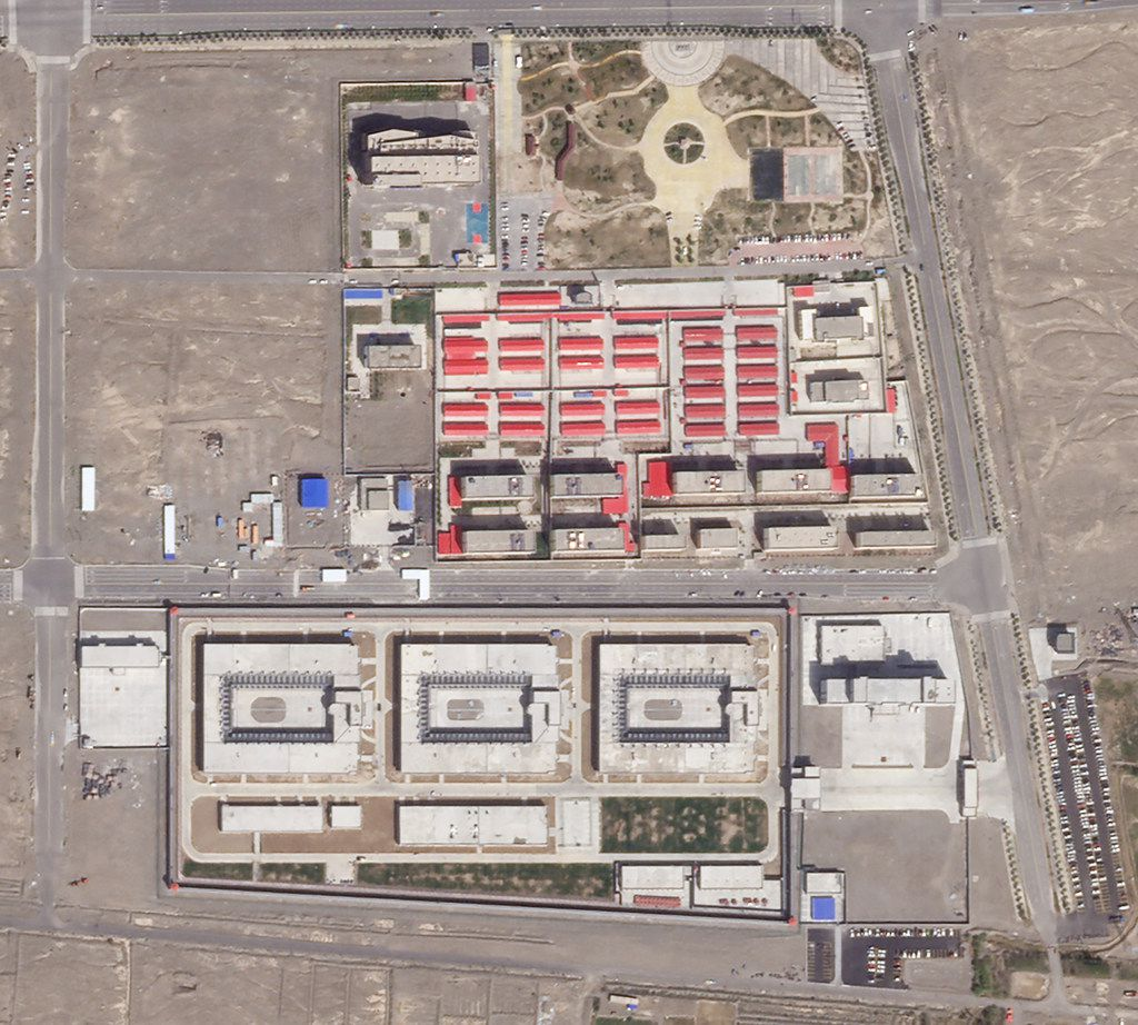 In this Sep. 17, 2018, satellite image released by Planet Labs, buildings are seen around the Kunshan Industrial Park in Artux in western China's Xinjiang region. This is one of a growing number of internment camps in the Xinjiang region, where by some estimates 1 million Muslims are detained, forced to give up their language and their religion and subject to political indoctrination. Now, the Chinese government is also forcing some detainees to work in manufacturing and food industries.