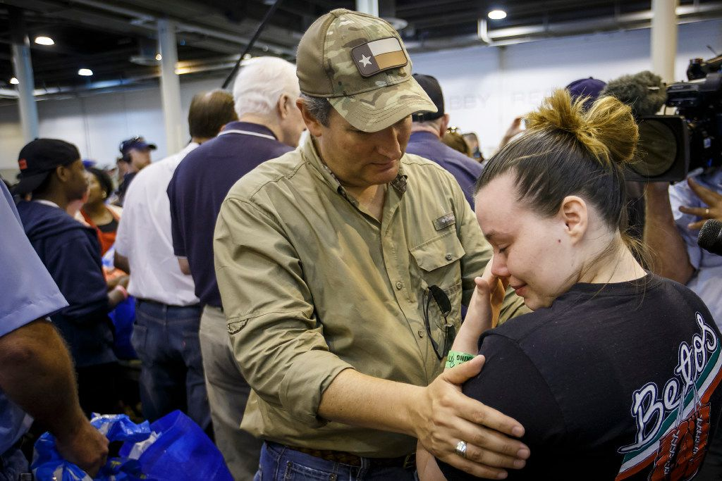 Hurricane Harvey evacuee Jennifer Nixon wipes away a tear as she is comforted by U.S. Sen. Ted Cruz while he toured the evacuation center at NRG Center on Monday, Sept. 4, 2017, in Houston. A group of elected officials met with evacuees and held a brief news conference in an effort to drum up support for emergency aid for Harvey victims.