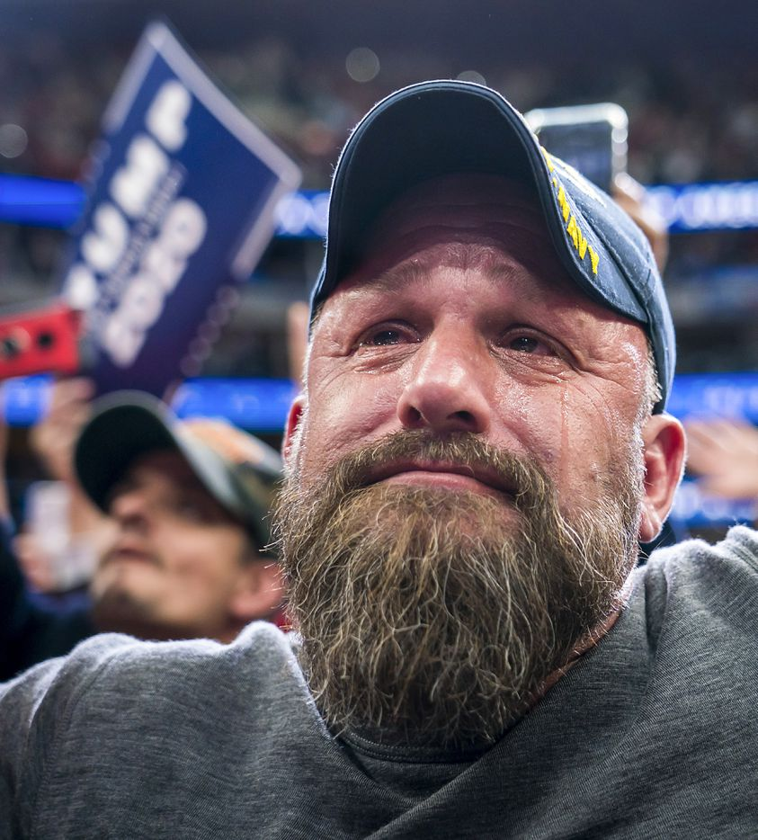 Navy Veteran Jase Wheeler of Flower Mound tears up as President Donald Trump speaks during a rally at American Airlines Center on Thursday, Oct. 17, 2019, in Dallas.