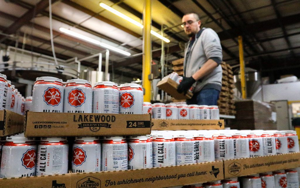 Jeremy Lee, packaging tech, stacks cans of All Call, one of the core beer brands at Lakewood Brewing Co., Wednesday, December 6, 2017.  If passed, the Senate GOP's tax plan would cut the excise tax on beer, wine and spirits which would benefit the Garland brewery.