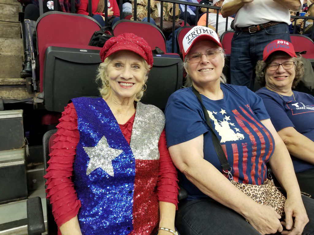 Ruth Ann Robinson, left in red, white and blue vest, from League City, Texas, and Alice Homan, 73, of Webster, Texas, attend the Donald Trump-Ted Cruz rally in Houston at the Toyota Center on Oct. 22, 2018. They want a border wall, and they want it electrified.