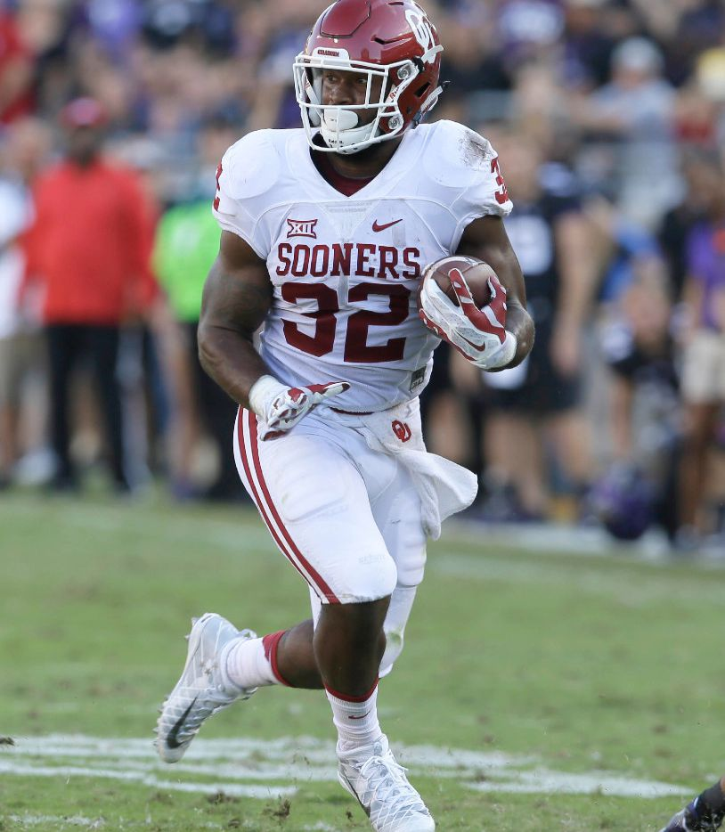 Oklahoma running back Samaje Perine (32) runs with the ball during the first half of an NCAA college football game against TCU Saturday, Oct. 1, 2016, in Fort Worth, Texas. (AP Photo/LM Otero)