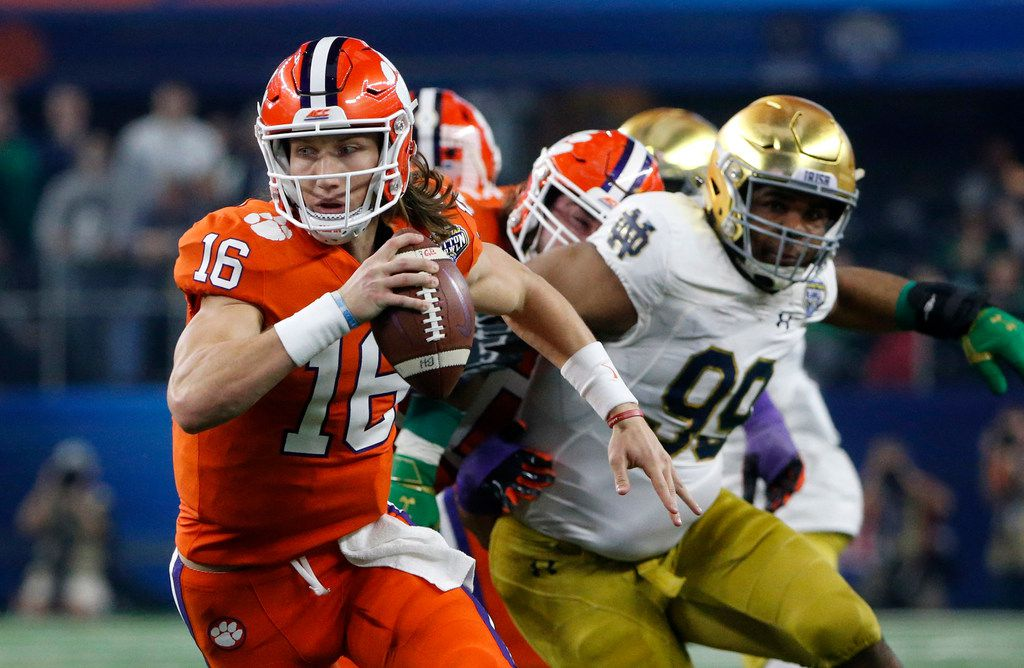 Clemson quarterback Trevor Lawrence scrambled out of the pocket during the Cotton Bowl playoff  game against Notre Dame in Arlington.  The lure of the matchup meant cash for local hotels.