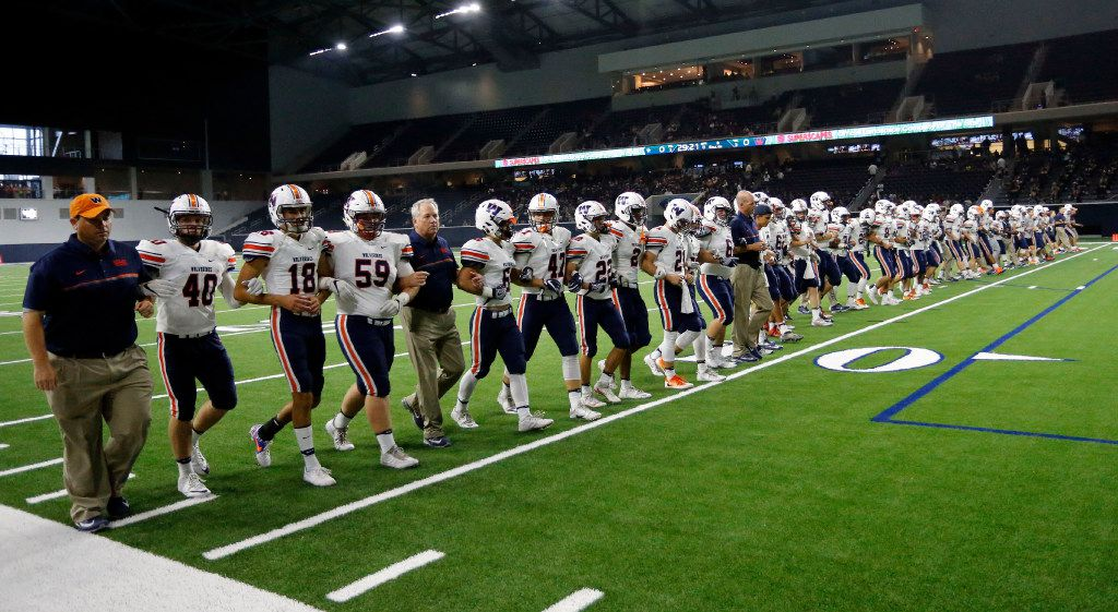 The Wakeland High team walks the field arm in arm before the start of their high school football game against Frisco Lone Star High on Friday, October 14, 2016. (John F. Rhodes / Special Contributor)