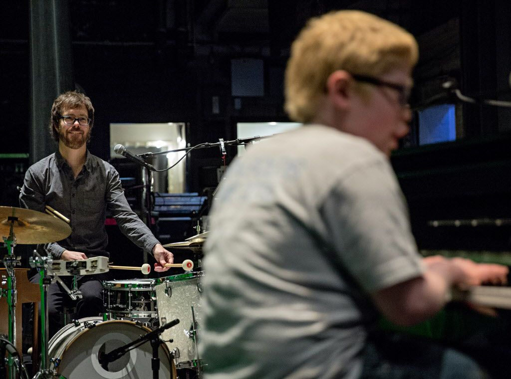 "Ben Folds (left) smiles as he plays the drums along with Ben Schneider at the Majestic Theater Thursday, April 14, 2016 in Dallas. Schneider, 11, who is both blind and autistic, learned to play Folds' song ""Sky High"" and considers the musician a hero. He was given the chance to meet Folds during an event for VIP's before his show Thursday night at the downtown Dallas venue. (G.J. McCarthy/The Dallas Morning News)"