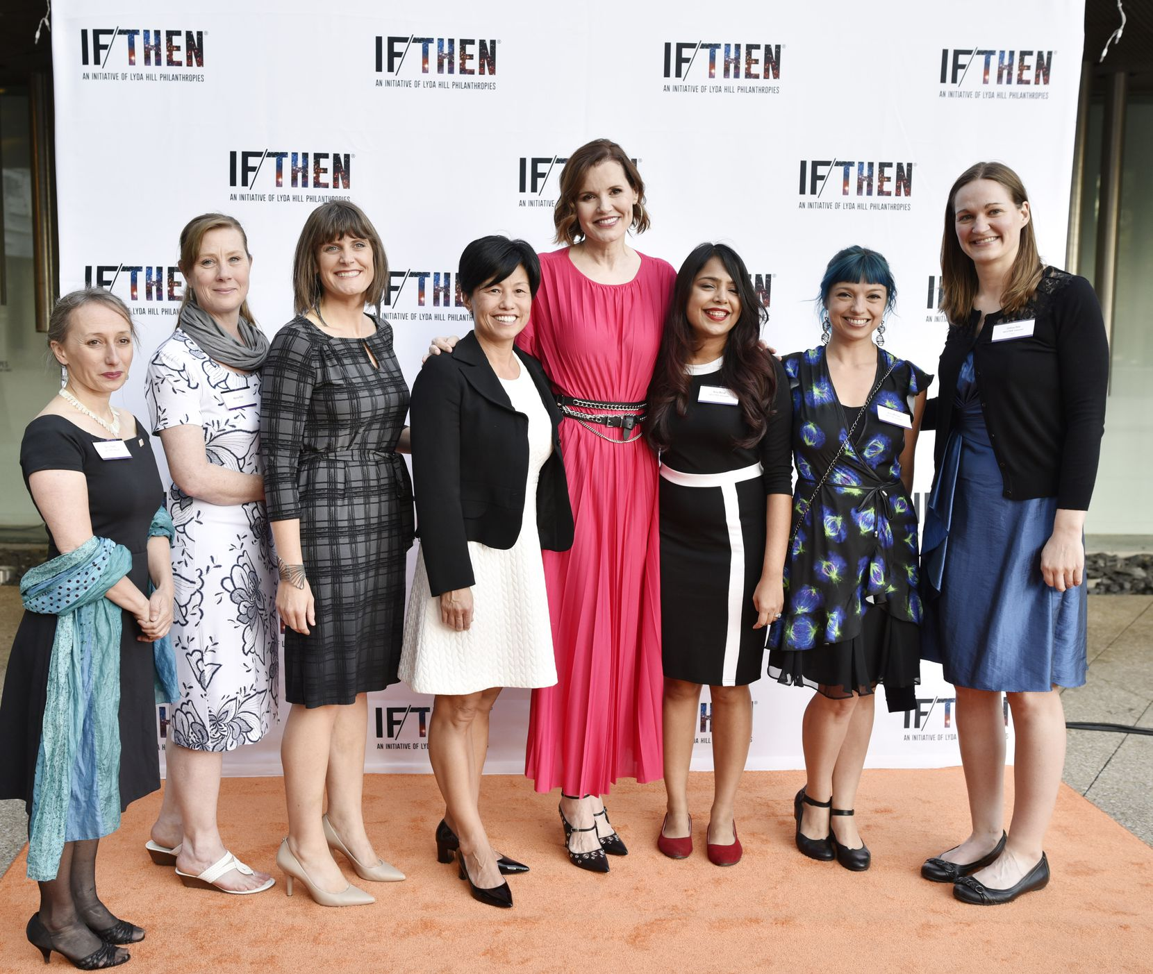 """Geena Davis, fourth from right, actor and founder of the Geena Davis Institute on Gender in Media, poses for a photo with IF/THEN Ambassadors and scientists during a red carpet event for the IF/THEN Ambassador Summit """"An Evening of Science and Storytelling,"""" at the Perot Museum."""
