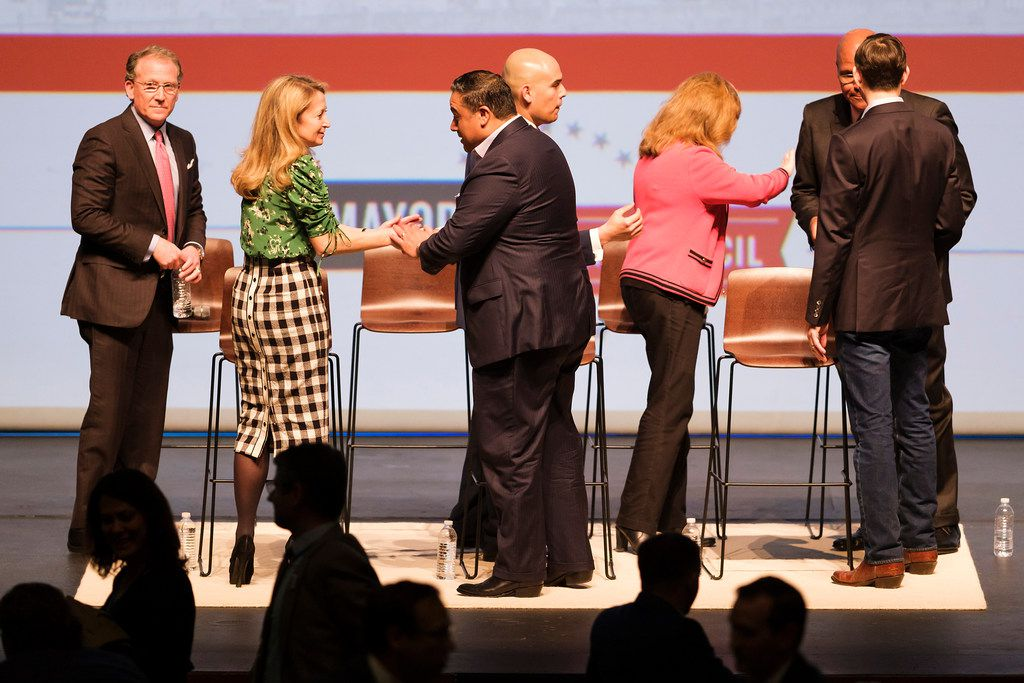 From left, Dallas mayoral candidates Mike Ablon, Lynn McBee, Jason Villalba, Miguel Solis,  Regina Montoya, Albert Black and Scott Griggs mingle at the conclusion of the Engage Dallas 2019 Mayoral Candidates Forum hosted by the Mayor's Star Council at the Music Hall at Fair Park on Friday, March 8, 2019, in Dallas. (Smiley N. Pool/The Dallas Morning News)